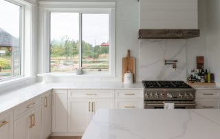 View of kitchen with Anlin glass packages