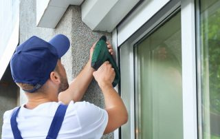 Man installing window (Retrofit vs. New Construction Windows)